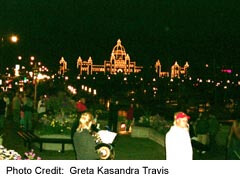 BC Legislature at night with band playing outside