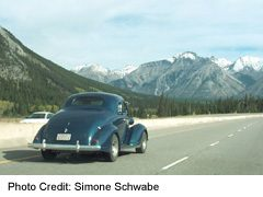 Classic Car travels on Highway 93, on way to/from the Radium Classic Car Rally