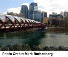 Peace Bridge across Bow River and Downtown Skyscrapers
