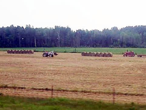 Farmers Baling Hay
