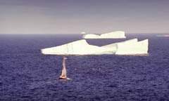 Iceberg off Newfoundland coast, with boat for scale