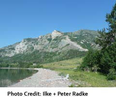 View of shoreline at Waterton Lake with mountains behind