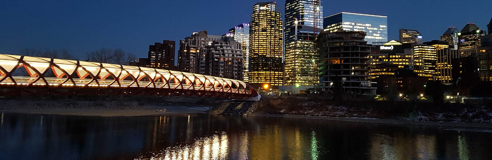 Calgary - Peace Bridge at night with reflection - sliver